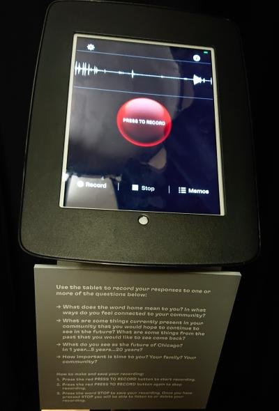 iPad in curtained booth, with recording app on screen.