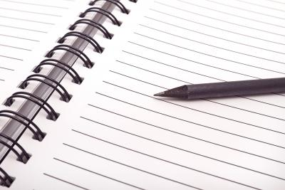 Writing in a notebook. Image credit: Unsplash.com.