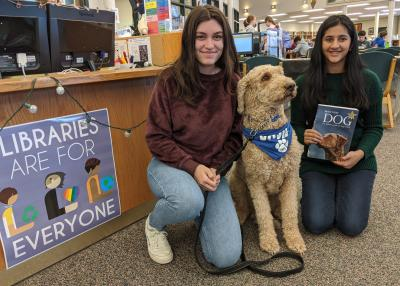 VHHS therapy dog Basil comes to read with students.