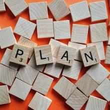 """Letter tiles spelling out the word """"plan""""."""