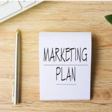 marketing plan written on notepad