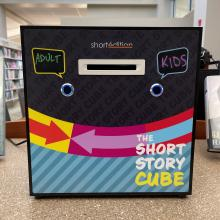 A photo of the Short Story Cube story dispenser.