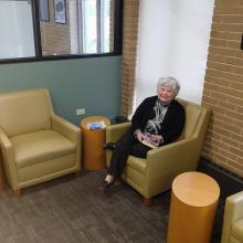 Library visitor sitting in an armchair.